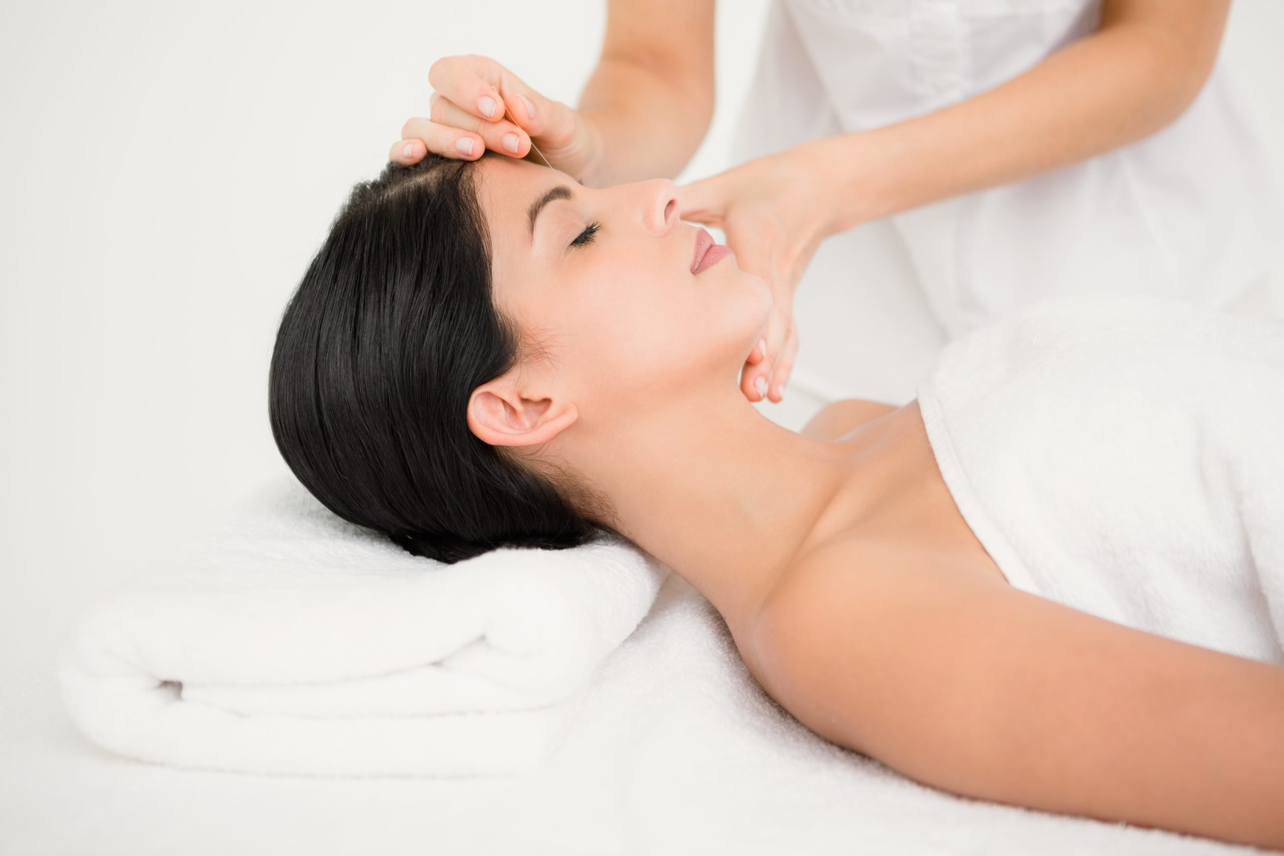 beautiful woman receiving acupuncture services